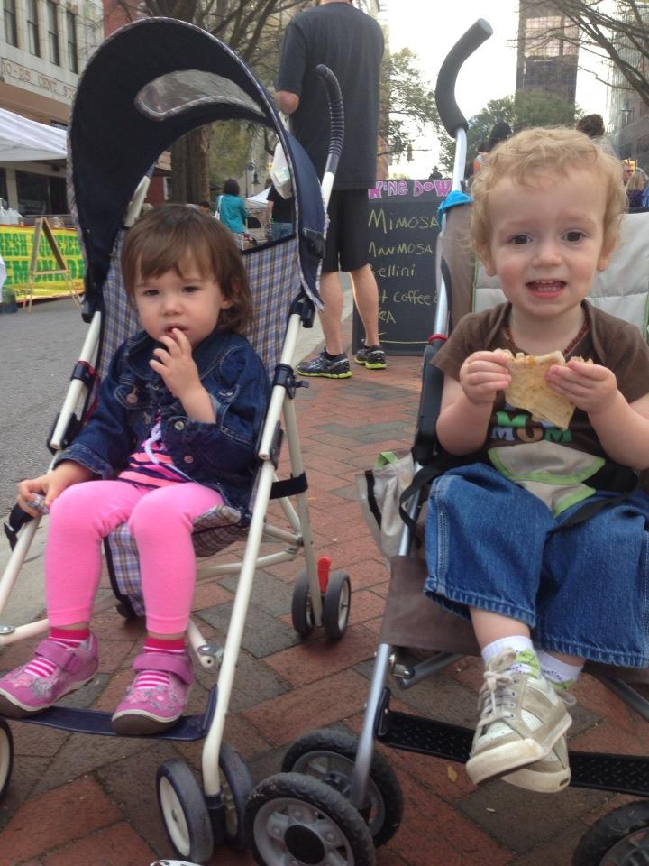 Nora and buddy Reid enjoying a crepe at Soda City Market
