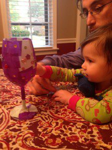 Nora and Daddy decorating Elijah's Cup