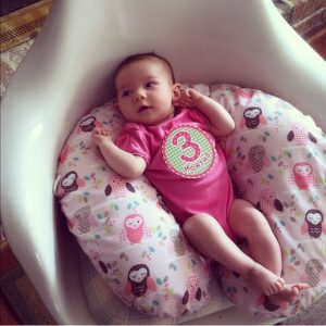 My sweet baby resting on her Boppy at 3 months old