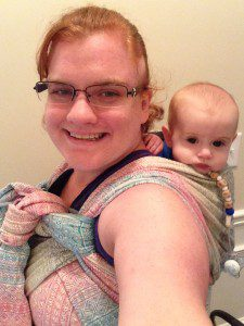 Barbara wearing Asher in a DIDYMOS(TM) Indio Aurora