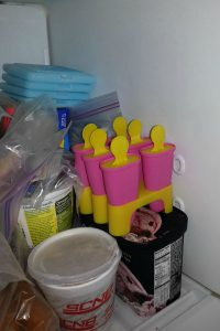 Juice pops are in the freezer waiting to get frozen.
