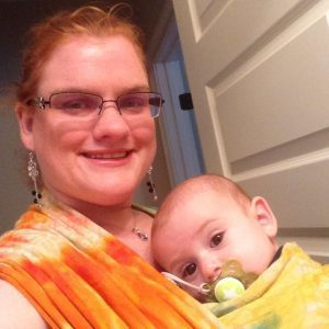 Wearing my son in baby wraps allows me to hold him without pain.