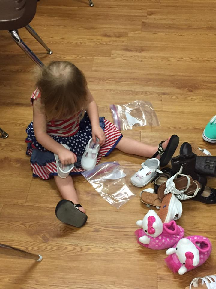 Lucie help sort baby shoes donated by other parishioners at our church.
