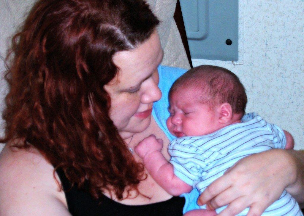 Author with newborn son