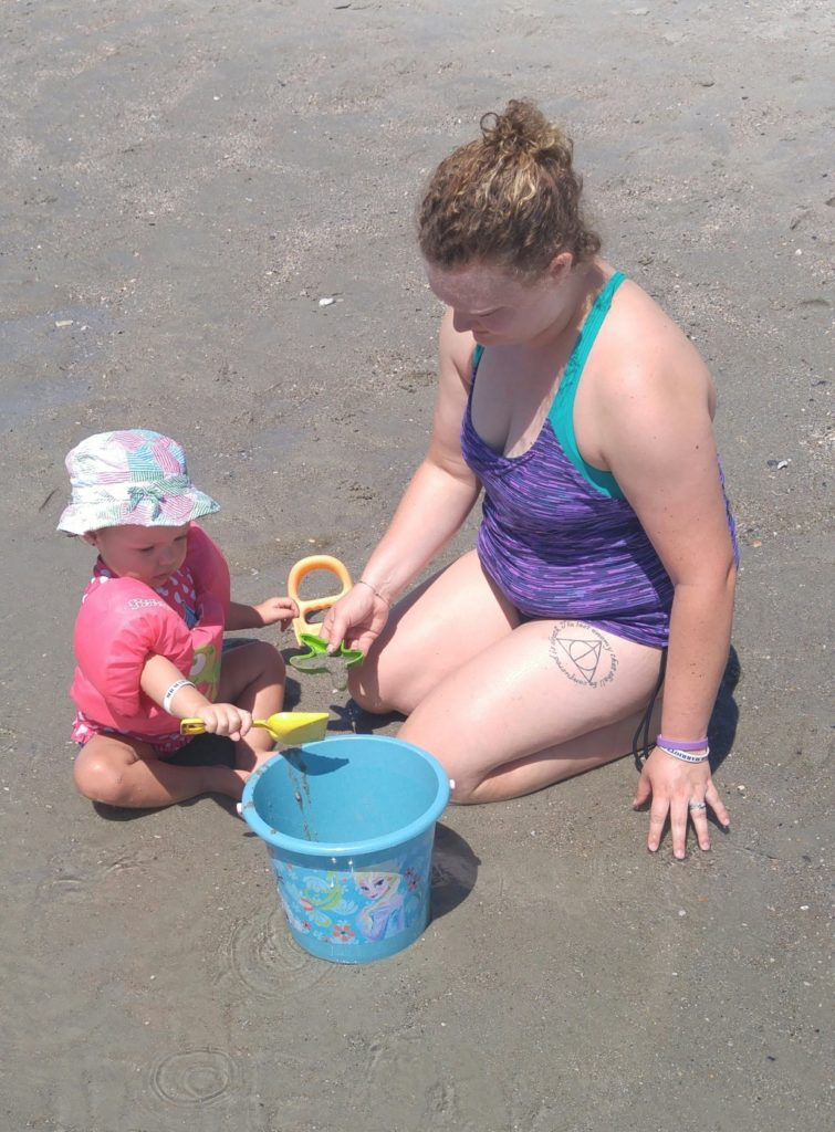 Playing in the sand with my two year old.