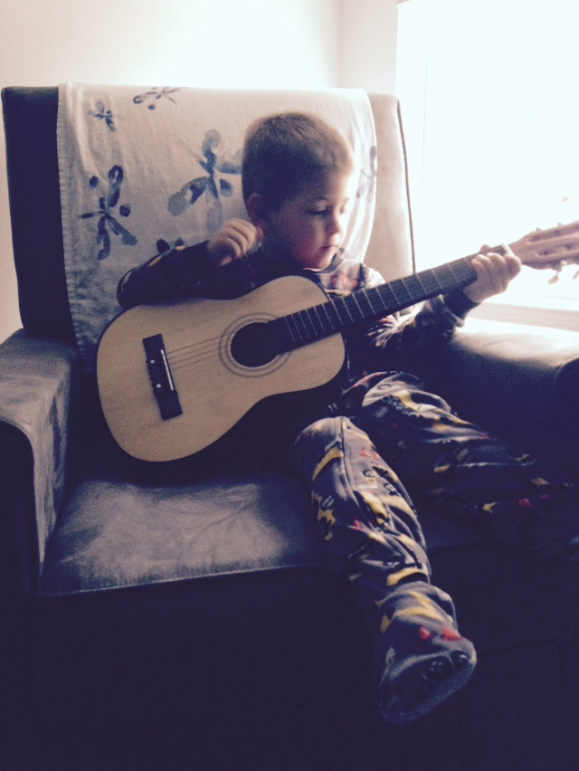 Child Playing Guitar | Columbia SC Moms Blog