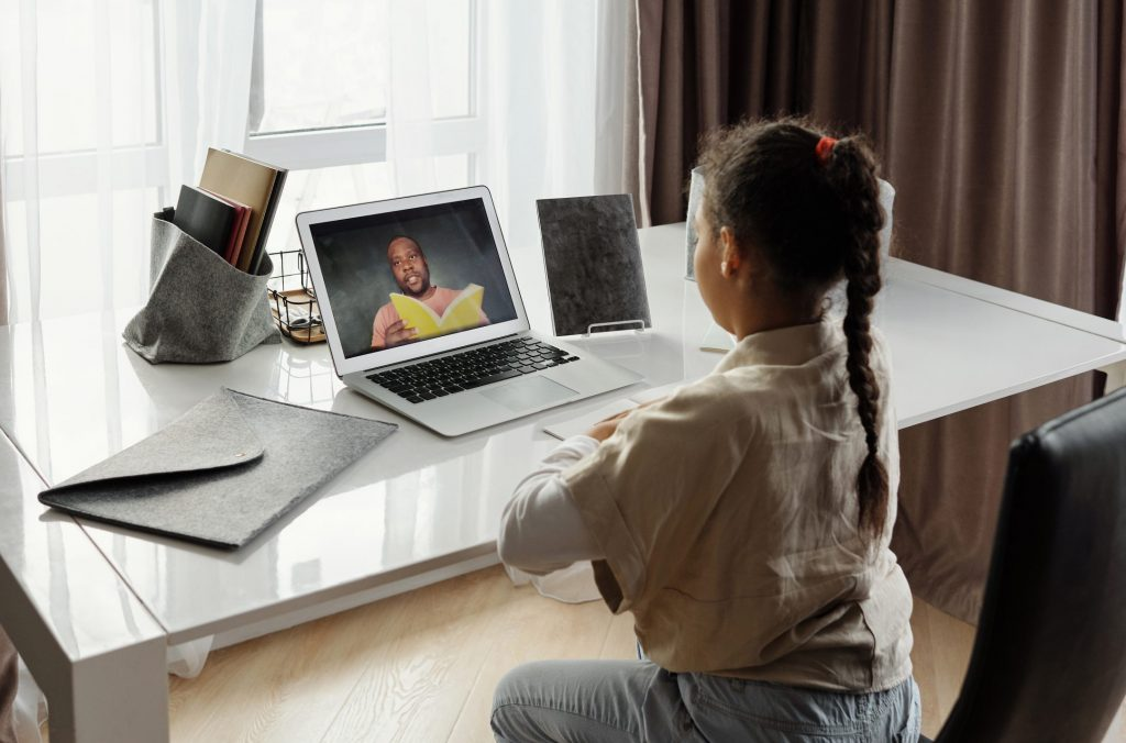 Little girl taking online classes